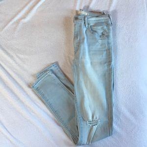 Levi's Mile High Super Skinny light wash jeans.